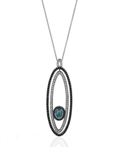 Carley Jewels - Lady Lago pendant    This striking pendant is crafted from 18k White Gold and features a feminine Cuprian Tourmaline surrounded by brilliant cut Diamonds and Black Spinel. As a reversible pendant, this darling piece is a serious multi-tasker, being able to sparkle in black and white or to keep it simple and show only it's Diamond side!