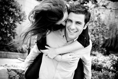 Funny black and white romantic engagement pictures in New York City. Love the chemistry and casual feel of this picture. Launi Photography