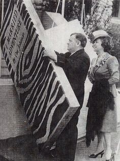 Osa Johnson watches New York mayor Fiorello LaGuardia sign a giant mock-up of her book, I Married Adventure.