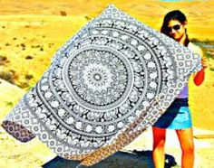 This is online indian printed black color mandala Tapestry like a girls women use it on beach