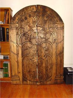 Doors of Durin hand carved book shelf.definitely need this in my hobbit home. Into The West, Lord Of The Rings, Middle Earth, The Hobbit, Hobbit Door, Lotr, My Dream Home, My House, Future House