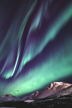 The colors of auroras over the mountains are vivid and can attract any onlookers attention.