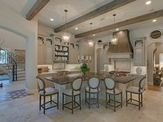 Pink ribbon house The kitchen welcomes with seating around a large L-shaped island, the perfect gathering spot for informal meals to fun family conversations. Look for beamed ceilings in rooms throughout the house for a rustic yet charming ambiance French Kitchen, New Kitchen, Kitchen Decor, Kitchen Ideas, Country Kitchen, Awesome Kitchen, Kitchen Designs, Beautiful Kitchens, Cool Kitchens