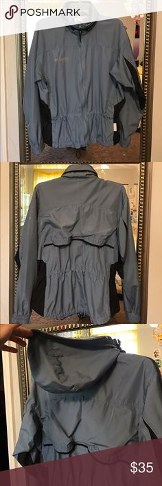 Adorable windbreaker In very good condition, just some stains (please see pictures). Nothing noticeable. Two pockets on the front. Adjustable waist. Also you can hide the hoodie if you prefer Columbia Jackets & Coats Utility Jackets