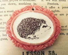 A personal favorite from my Etsy shop https://www.etsy.com/listing/245469226/hedgehog-pendant-english-hedgehog-focal
