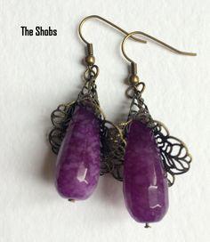 Purple Quartz EarringsGorgeous color in these purple quartz and Bronze Cap hangings Purple Quartz, Beautiful Earrings, Bronze, Cap, Color, Jewelry, Fashion, Baseball Hat, Moda