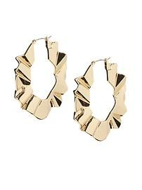 Love these earrings! Great spin on the traditional hoop :)