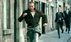 The main character running in the street