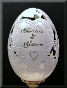 Amazing hand carved Goose egg that could be used as a wedding cake topper.