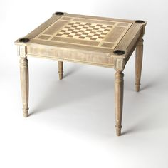 Features:  -Included: game pieces, dice, playing cards and cups.  -Made of select solid woods and choice veneers.  -Checker and chess board on top inset.  -Felt-lined blackjack table on opposite side