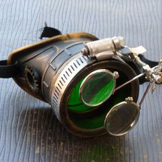 Steampunk goggles monocle eyepatch costume biker glasses green lens cyber gothic by oldjunkyardboutique on Etsy https://www.etsy.com/listing/183120398/steampunk-goggles-monocle-eyepatch