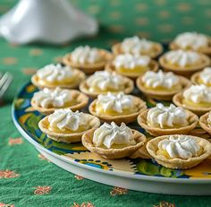 Mini lemon curd tartlets with whipped cream. | ethnicspoon.com