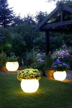 Buy a pot you like and use Rustoleum's Glow-in-the-dark paint. Paint absorbs sunlight and glows at night. AWESOME! ...cute, but wouldn't the light attract bugs?