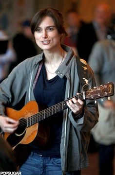 Keira Knightley spends a day on set playing guitar. | Keira Knightley Shares a Kiss and a Song on Set | POPSUGAR Celebrity Photo 8