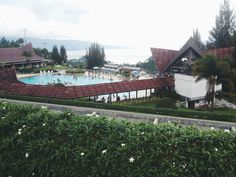 The view i got from balcony, we can see Lake Toba very clear from the park or swimming pool.   Lake Toba, Prapat, Indonesia.