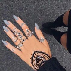 Matte grey nails with henna tattoo.