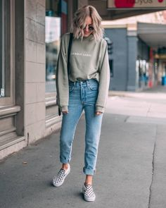 Denim jeans with comfy sweatshirt and cute sneakers.