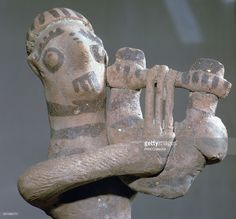 Orientalising period Minoan terracotta figure of a lyre-player from Arkades in Crete, now at the Archaeological Museum in Heracleion, Crete, 8th century BC.