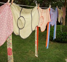 Apron Clothesline for backdrop at retro shower.  String a clothesline on the back wall and pin vintage or new aprons onto it.