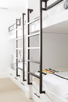 Studio McGee - Beautiful black and white bunk beds with fun pillows in a bunk room