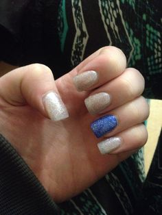 Sparkly nails with a blue ring finger