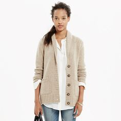 With its cozy shawl collar and playful mix of stitches, this plush merino wool cardigan is one you'll wear forever.