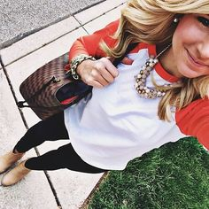 Love the big necklace with a t-shirt! Cool mix of casual and glamorous. I would wear a solid-colored tee instead
