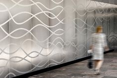 Wall panels in Stainless Steel with Seastone finish and custom Eco-Etch pattern at Van Ness Center, Washington, D.C.