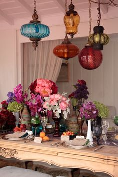 Love the lanterns, like the different vessels, like the deep purple and red flowers, maybe not as busy and not having flowers quite so high.