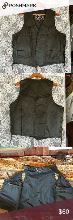 Zony Inc. Black leather biker vest Cool looking leather vest. I think it's kind of sexy. Worn once so in like new condition. Has slight smudge on back that I didn't notice until I went to post it. My husband prefers his Western vests so said sell it! Zony Inc. Suits & Blazers Vests