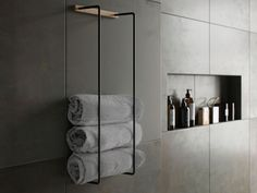Towel Rack is practical and stylish storage of your towels, that allows you to display your towels. The oak panels soften the black metal frame, giving your bathroom a hint of the spa look.