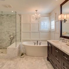 Really like this bathtub! Very peaceful master bath (minus the dark wood cabinets)