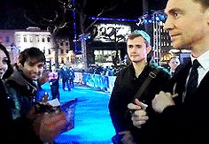 (gif) I love how he gives people these big hugs, without reservation. I'm not really a hugger, but I would do just about anything to get a hug from Tom.