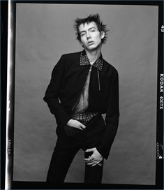 Embracing a punk cool, Paul Hameline wears a jacket and pants by Valentino.