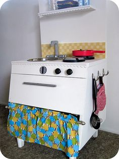 Love the details on this play kitchen - the back splash is made with painted Scrabble tiles!