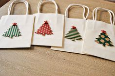 holiday gift bags christmas gift bags christmas tree gift bags white bags with trees by oscar & ollie. $15.00, via Etsy.