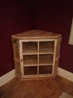 Latest project completed, corner cabinet made from pallet wood and an antique window.