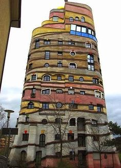 """The Austria artist and architect Friedensreich Hundertwasser is said to have once called straight lines """"the devil's tools."""" Hundertwasser d. Unusual Buildings, Interesting Buildings, Amazing Buildings, Modern Buildings, Architecture Design, Beautiful Architecture, Creative Architecture, Classical Architecture, Landscape Architecture"""