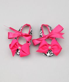 Take a look at this Hot Pink Damask Swavroski Bow Booties by Under The Hooded Towels on #zulily today!