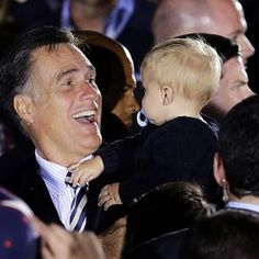 US Republican presidential candidate Mitt Romney greets a child during a campaign event in Virginia (AP)