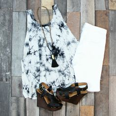 If you love the hippie look and need something cool and comfy, this black and white tie-dye tank is JUST what you need! Only $26 at Entourage!