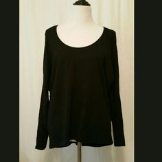 Casual black hi-lo top Casual black top with hi-lo hemline. Sheer across shoulders. NWT Nine 1 Eight Tops Tees - Long Sleeve