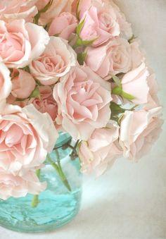 Pink roses in vintage aqua mason jar