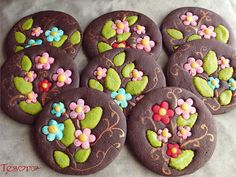 chocolate sugar cookies decorated with multi colored dough