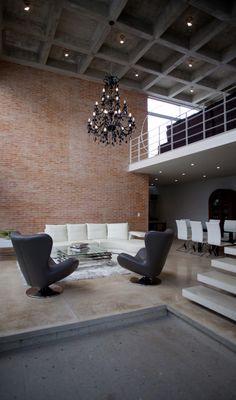 Modern. Loft. Living Space. Chandelier. Brick. Minimalist. Home. Interior. Black and White. Design. Decor.