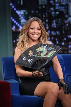 "A true diva brings her own fan. Mariah Carey cools off during an appearance on ""Late Night With Jimmy Fallon"" on Nov. 12 in New York"