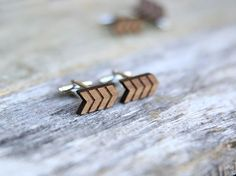 Minimalist design on an arrow shaped cufflink. The pair of cufflinks feature opposing patterns, so that the two cuffs create a whole. Perfect for the lover of symmetry.  We have laser cut and hand crafted these cufflinks from 3mm thick walnut wood. The cuffs are 16mm in diameter and are finished with a strong, clear lacquer for protection.  All cufflinks are wrapped in brown kraft bags.  Note: wood grain may vary slightly from photograph.