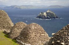 Spectacular Skellig Islands off the Kerry coast. The monastic site on Skellig Micheal is reached by climbing over five hundred steps up a 1000 yr old stone stairway. Stone beehive huts where monks lived & prayed centuries ago cling to cliff edges. These isolated arch. remains show the dramatically spartan conditions in which this early Christian community lived. Enduring several Viking raids, the monks eventually left the island in the 13th century & it became a place of pilgrimage.