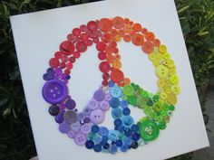 How very pretty It really appeals to me with the symbol and because of my love of buttons : Peace & Rainbowson 12 x 12 Canvas Any letter color by alphabutton, $19.99