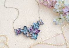 This necklace are made from bronze , crytal and is add to the hand-crafted flowers  Rose and leafs are handmade by polymer clay and acrylic paint